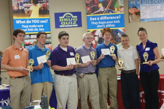 Peer advisor Luke Brown, 17, students Nate Brower, 14, of DeWitt, Anthony Basile, 13, of Syracuse, Brennan Corman, 13, of North Syracuse, Dan Kelly, 13, of Syracuse, and Shawn Moreth, 14, of Syracuse, are joined by advisor Laura Dermott after winning first place at the regional Drug Quiz Show.