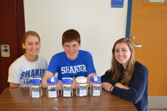 "The Shaker High School World of Difference Club raised money for organizations in Uganda and Haiti through the ""Give Change, Make Change"" campaign. Left to right are WOD club members Kaitlyn Cheney, Brian Hickey and Emily Nicol."