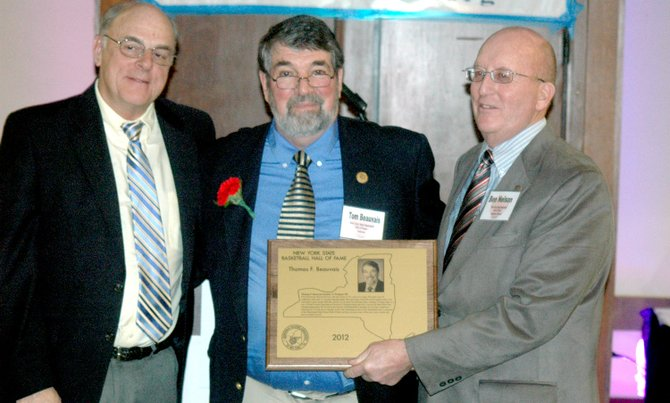 Retired Westport teacher and coach Tom Beauvais, who was inducted into the Basketball Coaches Association of New York's Hall of Fame, is one of six to be inducted as the first members of the schools' Wall of Distinction.