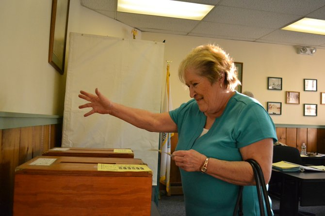 Patricia Aborn casts her ballot at the Champlain Village Offices March 20. The incumbents held their seats there. In Rouses Point, Francis Baker's vote tally earned him the mayor position.