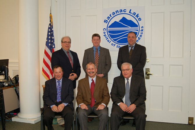 Saranac Lake Village Board members pose for their official photograph on March 13. From left, front row, are Trustee Elias Pelletieri, Mayor Clyde Rabideau and Trustee John McEneany. From left, standing, are trustees Tom Catillaz and Jeff Branch and Village Manager John Sweeney.