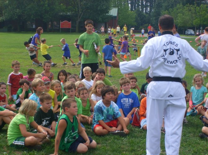 Past summer camp activities include martial arts demonstrations.