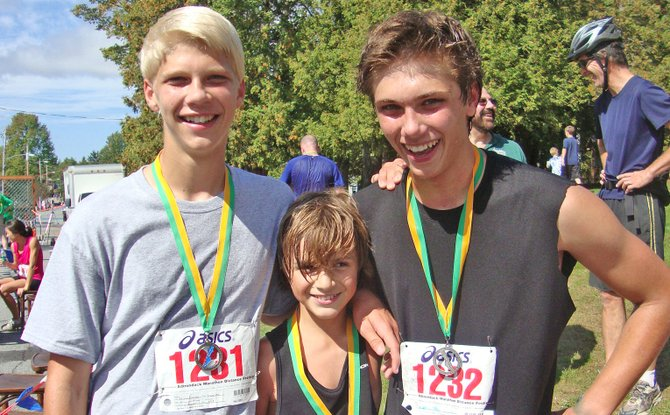 Schroon Lake Central School runners completing the Adirondack Half Marathon last fall were, from left,  Dan Maisonville, Levi Williams and Caleb Maisonville.