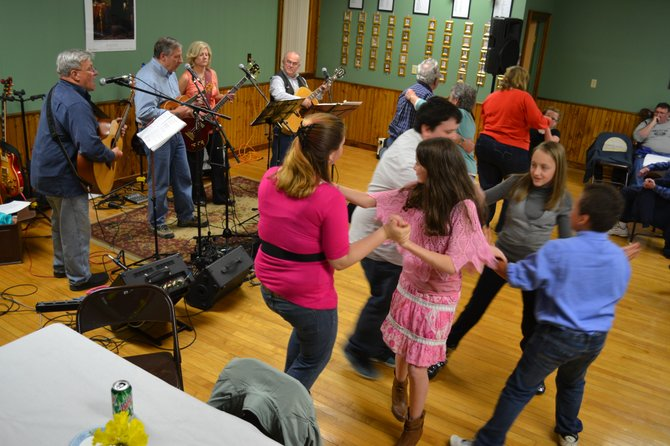 The Ellenburg youth group from St. Edmund's cuts footloose after an evening of helping out at the town hall revival concert March 24.