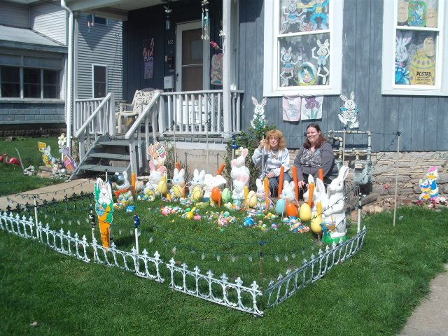 Deborah Green, left, and daughter Kerry Ann Green pose on their front lawn where they have been putting up seasonal decorations for the past 12 years.