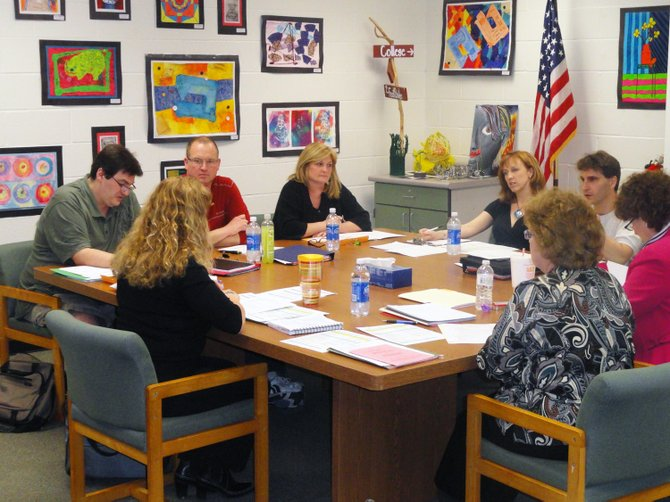 Members of the Elizabethtown-Lewis Central School Board of Education meet with ELCS administration during a recent budget workshop.