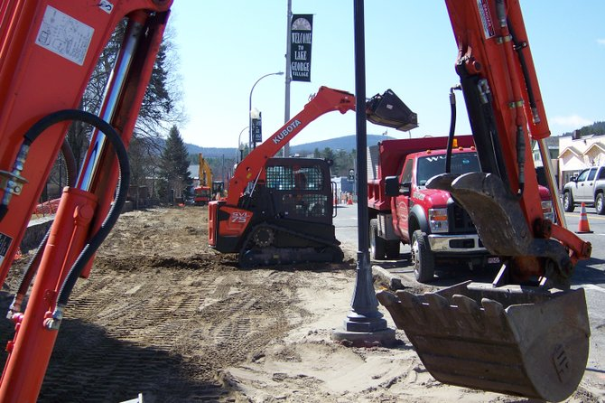 Workmen excavate the sidewalk March 26  on Canada St. in front of Shepard Park in Lake George as part of a streetscape reconstruction effort now underway. The project, which calls for new sidewalks, benches and plantings similar to the other side of the roadway, is expected to be finished in several months, according to the Rich Spoto of Woodchips Carpentry, the construction firm conducting the work. Monday night, the village board approved borrowing $563,000 for one year to bankroll the project.