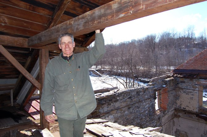Will Heintz stands on the remaining third floor of the former Willsboro grist mill he has been restoring for the past 6 years. 