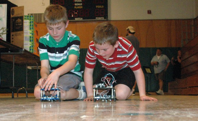 Lucas and Gavin Spilling show off their robotic prowess during the Elizabethtown-Lewis Science Fair.