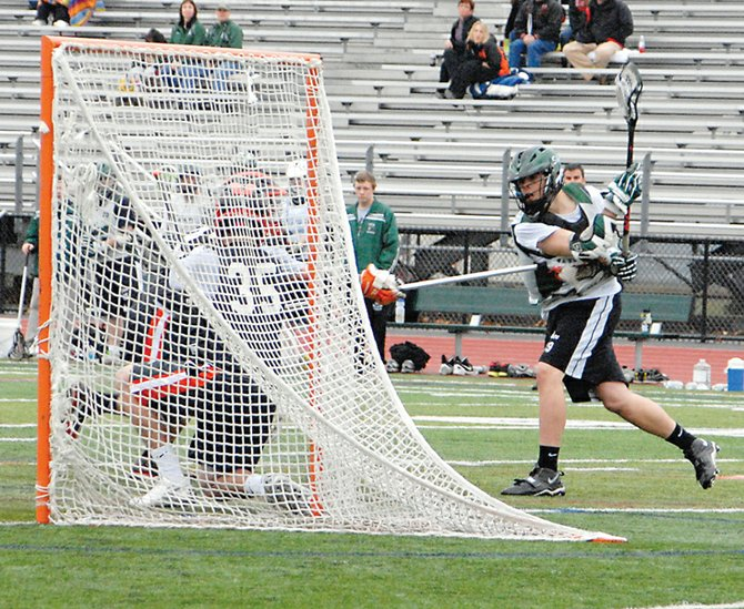 Shenendehowa's Brian Rogers, right, shoots the ball during last Sunday's multi-team scrimmage in Clifton Park.