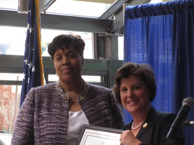 Linda Donalson Hicks, left, was presented with the Syracuse Woman of the Year Award by Syracuse Mayor Stephanie A. Miner on Wednesday at the Sustainability Center.