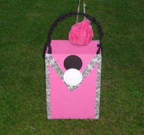"""A silent purse auction to benefit CRIS will be held on May 9 and 10 throughout Cazenovia. """"Pink purse"""" drop-boxes have been placed around town to collect new or gently used purses."""