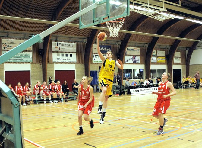 Heather Stec sails toward the hoop while playing for the STOL-Grasshoppers in the Dutch professional womens basketball league in 2011. During her career in Holland, Stec averaged 21.4 points per game.