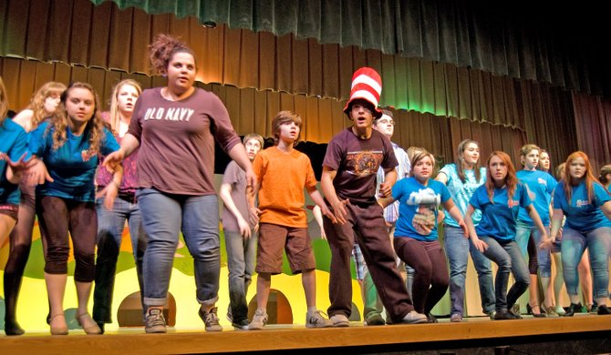 "Cast members, including senior Michael Perkins as the Cat in the Hat, rehearse ""Seussical the Musical"" at Mohonasen High School."