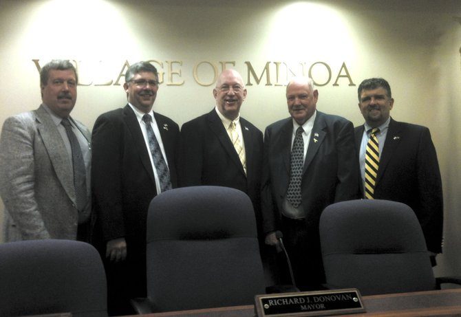 Pictured from left are village of Minoa Trustee John H. Champagne, Trustee Eric Christensen, Mayor Richard J. Donovan, Trustee Ronald L. Cronk and Deputy Mayor William F. Brazill. Cronk's last meeting as trustee was Monday, March 19.