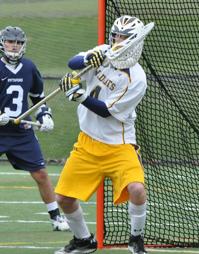 West Genesee boys lacrosse goalie Scott Sidnam (4) making one of his 12 saves that keyed last Saturday's season-opening 9-6 victory over Pittsford.