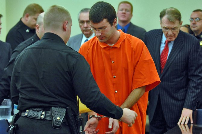 Christopher Porco is placed in handcuffs at his 2006 sentencing.