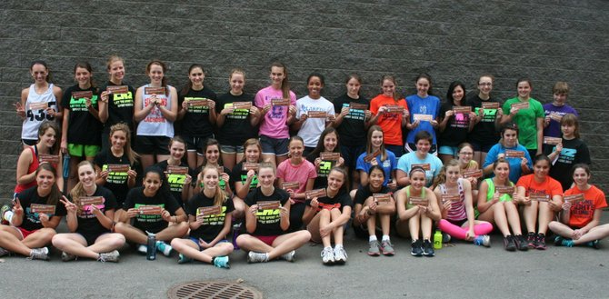 "Members of the Cazenovia girls varsity track team pose together after committing to ""Be the Wall"" for each other. The promise is  part of Caz Action's community-wide initiative to curb substance abuse. Each athlete on the team roster took the pledge."