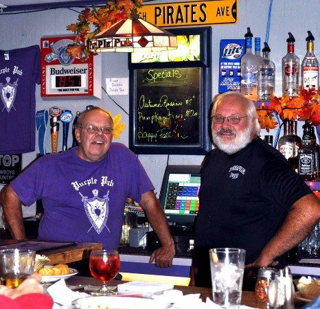 Bob and Greg Rentz (left and right, respectively) opened the Purple Pub in 1972 with the help of their parents. The restaurant celebrates 40 years of business on Sunday, April 15.