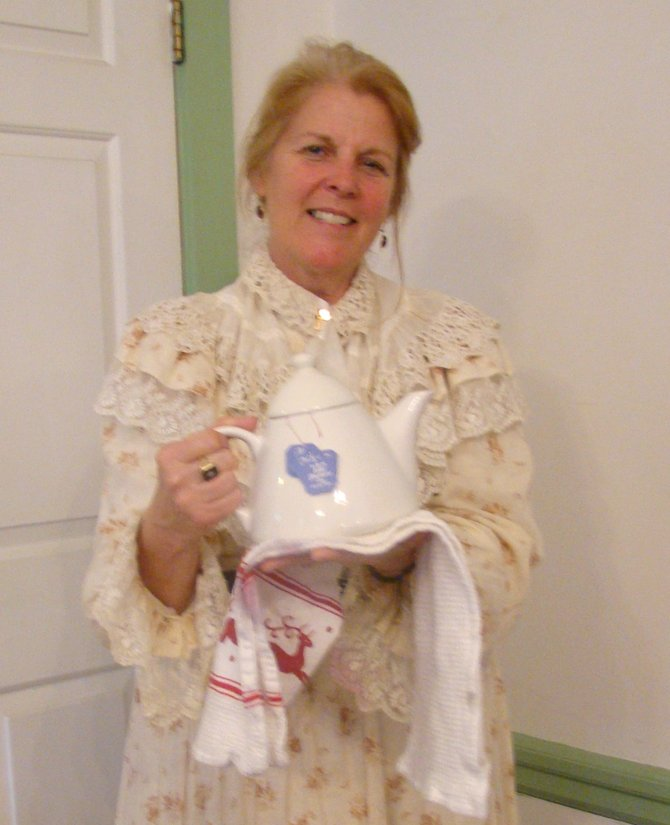 Susan McLane serving tea from a pot of the Victorian era. Shell be presenting a program on the Titanic at the Brookside Museum in Ballston Spa on Sunday, April 15.