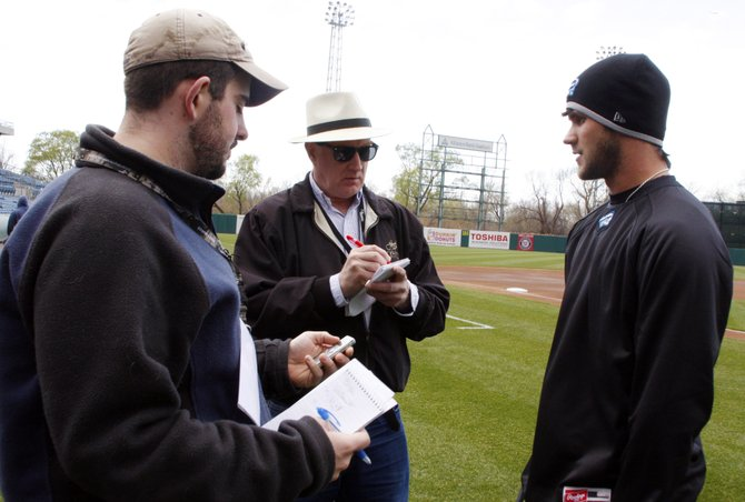 Bryce Harper fields questions from The Eagle reporters Neil Benjamin, left, and Russ Tarby, center, on media day.