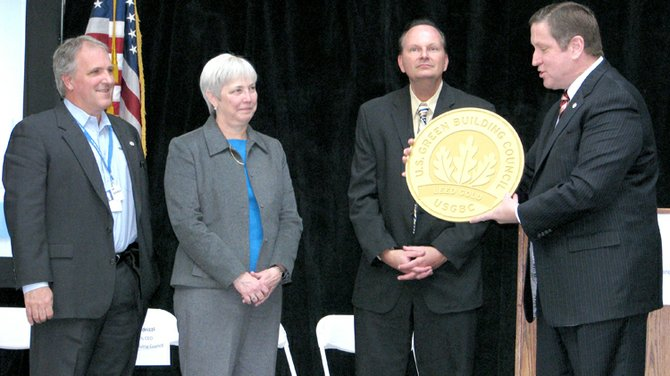 Rick Fedrizzi, right, president, CEO and founding chairman of the USGBC, presents members of the Welch Allyn team with the Leadership in Energy and Environmental Design Gold certification plaque, which now hangs on a designated wall inside the building. From left are fourth-generation owner Eric Allyn, president and CEO Julie Shimer and Welch Allyn Director of Operations Scott Spanfelner.