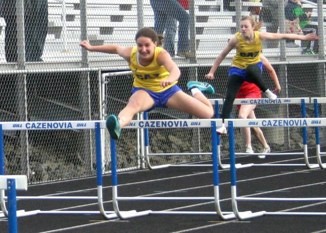 Paige Biviano, left,  led the Lakers with victories in the 100 meter hurdles (above), long jump, high jump and 4x100 meter relays as Cazenovia overwhelmed ESM 100 to 41. Freshman Ashley Kent, right, was second in the 100-meter hurdles and won the 400-meter hurdles as Cazenovia captured all 11 events on the track.