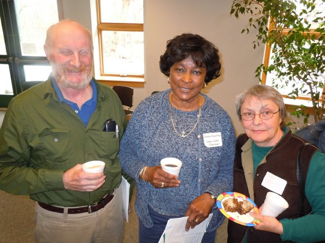 From left, Doug Cole of Mountainaire Massage in Wevertown, Brenda Valentine with the Indian Lake Chamber and Joanne Smith of North Creek attend the Adirondack Economic Development Conference April 10 at the Tannery Pond Community Center.