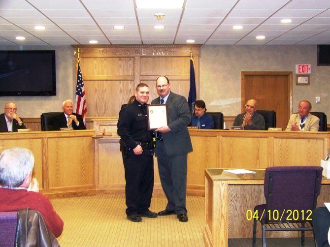 Officer Jay Pollard and Police Chief Tom Winn at the Camillus Town Board meeting. Pollard was recognized as the Officer of the Year for 2011.