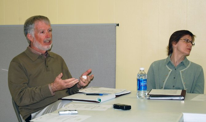 Project Hope Field Coordinator Mike Bigley talks with Gretch Sando, program coordinator for Project Hope Clinton/Essex.