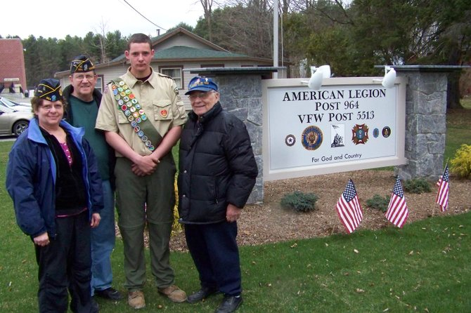 Area Legionnaires (from left): Joanne Ellsworth, Joe Slattery and Lou Russo (right) surround Chester Eagle Scout Jacob Hill (center) April 12 beside the sign, flagpole setting and landscaping Hill developed for Legion Post 964 as an Eagle Scout project.
