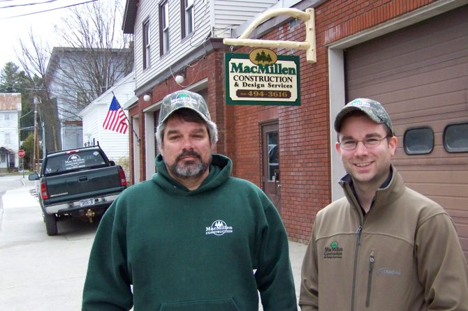 Contractor John MacMillen (left) and architectural designer Michael Rice (right) pose in front of their enterprise's new headquarters in the former Chestertown firehouse.