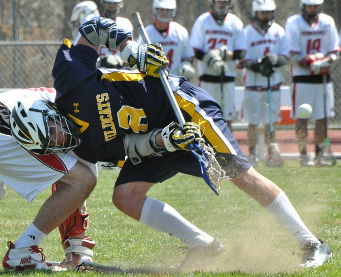 West Genesee midfielder Matt Schattner (8) goes for a face-off during last Fridays game at Baldwinsville. Schattner had two assists as the Wildcats beat the Bees 8-1.