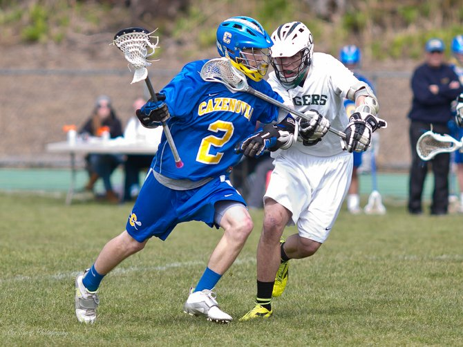 Cazenovia midfielder Henry Mann caries the ball past an OCS defender. Strong defense held the Tigers to only three goals in the Lakers 12-3 victory. The varsity boys squad has two road games against Skaneateles and Lafayette this week.