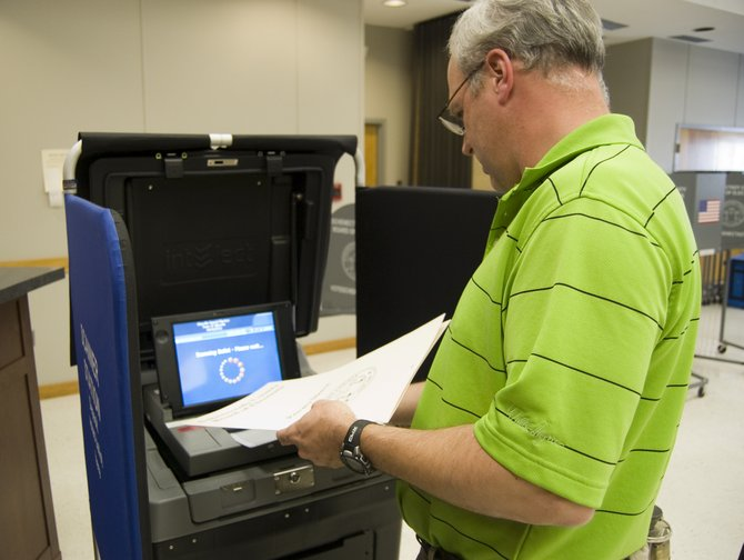 Glenville resident David Hennel casts his vote during the special election held at Glenville Town Hall on Monday, April 16. Voters approved changing the receiver of taxes from an elected to part-time position by 210-75, according to unofficial results.