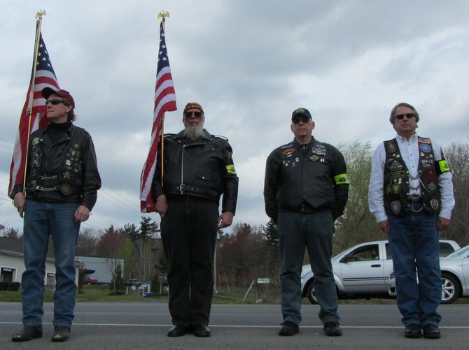 Members of the Patriot Guard Riders held flags during a ceremony dedicating John J. McKenna IV Way in Clifton Park on Sunday, April 15.