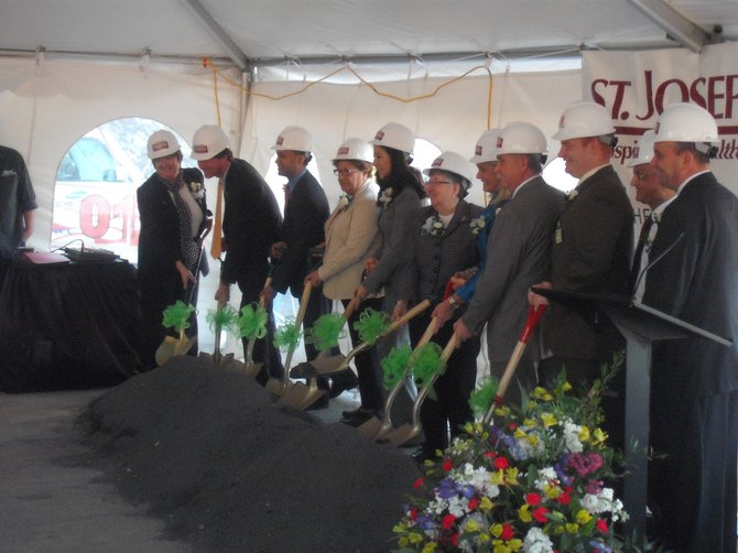 Members of the St. Joseph's Hospital board of directors and donors break ground on Phase Two of their expansion project, a new six-story building downtown.