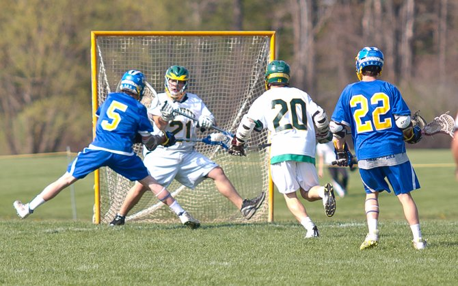 Midfielder Brad Nardella (5) gets the ball past the LaFayette goaltender for one of his four goals on April 19. After its victory over Jordan-Elbridge, the varsity boys team season record advanced to 7-0. Coming off last year's state-championship season, the team has won 26 consecutive games.