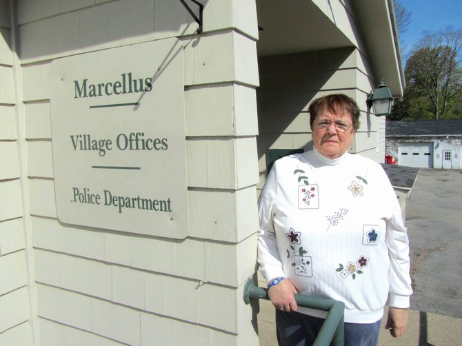 Sally Tallman stands outside Marcellus Village Hall. She was sworn in as trustee April 2.