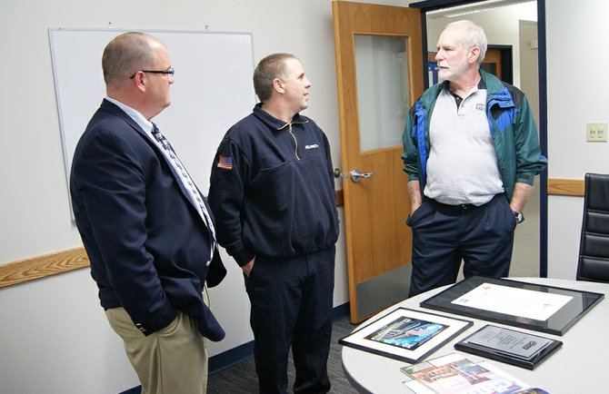 Mayor Mark Olson, Fire Chief Paul Hildreth and Architect Dennis Ross talk about the three awards the fire house design has won.