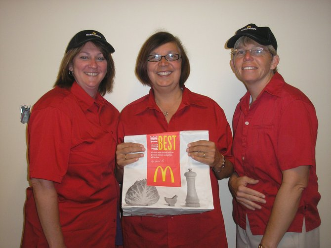 "The annual ""McTeacher Night"" in Ticonderoga will be held at McDonald's Tuesday, May 1. Teachers will be flipping burgers and cooking fries 4:30 to 7 p.m. Preparing for the event are, from left,  Kathy Moore, Shannon Huntington and Shelly Young."
