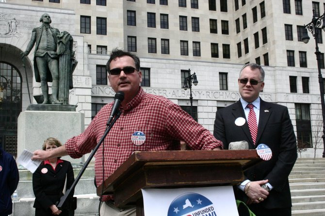 Addressing a rally protesting unfunded mandates held Saturday April 12 at the state Capitol, Queensbury at-large Supervisor  Mark Westcott says that such dictates are forcing local governments to abandon vital services. Warren County Board of Supervisors Chairman Dan Stec (right) also spoke at the rally, sponsored by the Upstate Conservative Coalition.