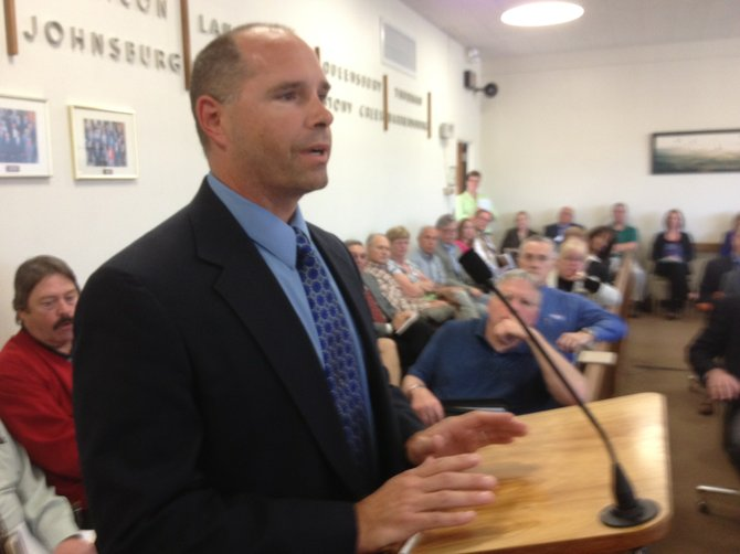 Dave Wick, new Executive Director of the Lake George Park Commission, thanks Warren County supervisors at their April 20 board meeting for their support and cooperation during the last 19 years as his role as the director of the Warren County Soil and Water Conservation District. The board meeting drew a fair crowd, including people who offered opinions on expanding the county property tax exemption for the aged.
