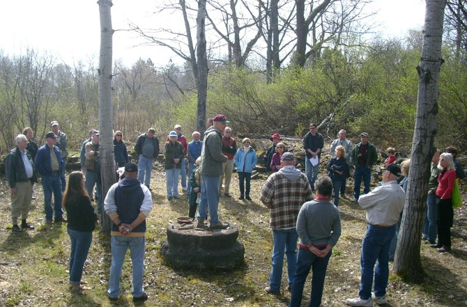 Cazenovia residents gather at the railroad turntable and original wall just off the Fairchild Hill trail on the old Syracuse and Chenango Valley Railroad to listen to John Taibi and Jim Georges during a CPF-sponsored Walk N' Talk on Saturday, April 14.