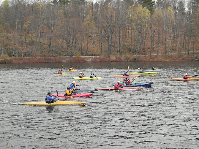 Paddlers compete in a past Hudson River White Water Derby