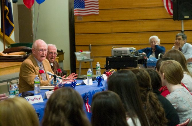 World War II veteran William Rochelle Jr. talks to eighth-grade students at Iroquois Middle School in Niskayuna on Thursday, April 19, during a panel talk with fellow veterans on their experiences during the war.