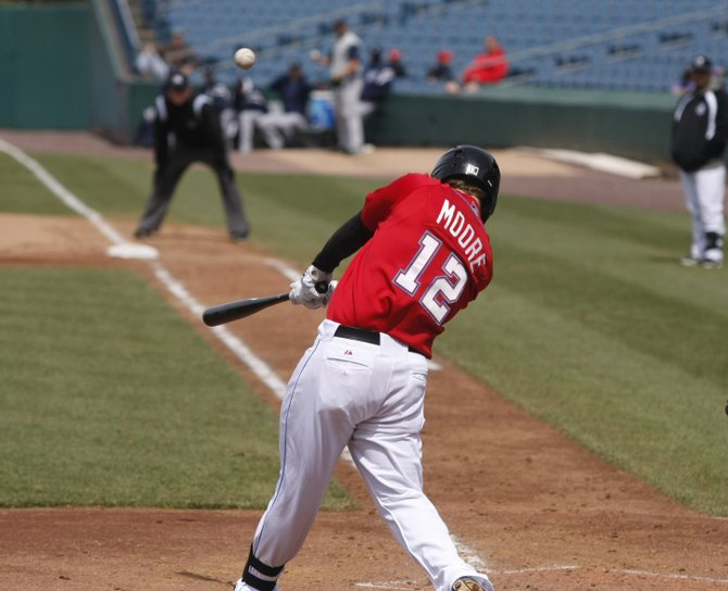 Syracuse Chiefs power-hitting first baseman Tyler Moore was called up to the Washington Nationals on Sunday, April 29, the day after outfielder Bryce Harper made his big-league debut with the Nationals in Los Angeles. He's pictured here hitting his last home run for the Chiefs Saturday.