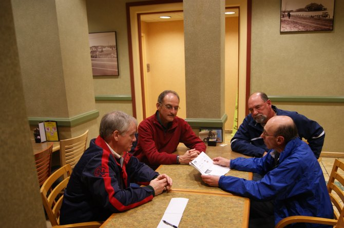 From left, former Marcellus baseball head coach Pete Birmingham, assistant coaches Larry Craft, Jim Alford and Mike Bome sit down to discuss what transpired with their former baseball team.