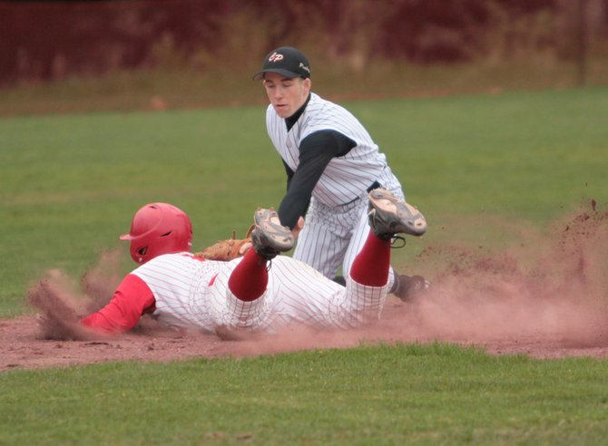 Schroon Lakes Jeffery Armstrong slides into third base as Crown Points  Gabe Macey applies the tag. Crown Point blanked Schroon Lake, 4-0, in Mountain and Valley Athletic Conference baseball action April 30.