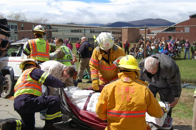 Student Brody Hooper is loaded into a body bag as EMTs cut through the vehicle with jaws of life in the Mock Car accident at Elizabethtown Lewis School to warn students of dangers of drinking and driving. 